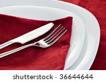 place setting detail with fork and knife - stock photo