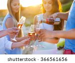 happy friends pouring champagne ... | Shutterstock . vector #366561656