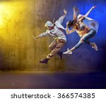 sporty hip hop dancers | Shutterstock . vector #366574385