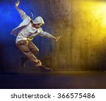 sporty hip hop dancer jumping | Shutterstock . vector #366575486