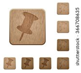 set of carved wooden pin...