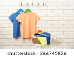 male clothes on hangers in a... | Shutterstock . vector #366745826