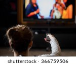 young girl watching tv with