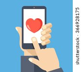 heart on smartphone screen.... | Shutterstock .eps vector #366928175
