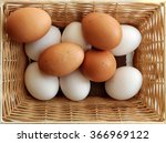 A Set Of Yellow And White Eggs...