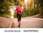vital senior woman jogging in... | Shutterstock . vector #366989882