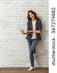 young beautiful woman using a... | Shutterstock . vector #367274882