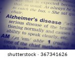 Small photo of Close up of English dictionary page with word Alzheimer's disease