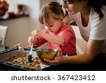 Child Baking Cookies Together...
