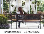 alone girl sitting on bench  in ... | Shutterstock . vector #367507322
