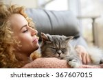 Young Woman And Cat On Sofa In...