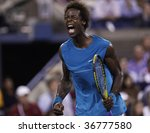 NEW YORK - SEPTEMBER 8: Gael Monfils of France reacts during 4th round match against Rafael Nadal of Spain at US Open on September 8, 2009 in New York - stock photo