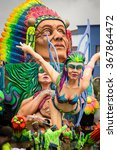 """Small photo of PASTO,COLOMBIA-JANUARY 6 2015 : Detail of allegorical car an people during the """"Carnaval de Negros y Blancos"""" (Carnival of Black and White) parade at Pasto, city located south of Colombia."""