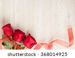 Stock photo red roses on wooden background valentines day background 368014925
