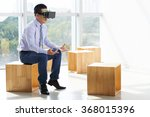 businessman in virtual reality... | Shutterstock . vector #368015396