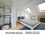 loft bed room with en suite bathroom and room window - stock photo