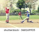 Boy Sliding Into Base During A...