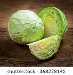 Cabbage And Cutted Cabbage On...