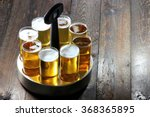 served Koelsch (specialty beer from Cologne) in a typical tray on wooden background
