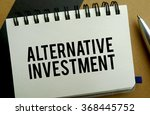 Small photo of Alternative investment memo written on a notebook with pen