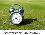 Alarm Clock On Green Grass...