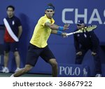 NEW YORK - SEPTEMBER 10: Rafael Nadal of Spain returns a shot during quarterfinal round match against Fernando Gonzalez of Chile at US Open on September 10 2009 in Flushing, New York. - stock photo