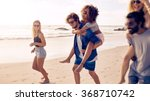 two happy young men giving... | Shutterstock . vector #368710742