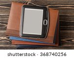 Small photo of E-book reader close-up on wooden background