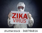 Small photo of Zika virus concept, medical worker in protective clothes showing alertness poster