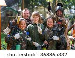 Happy team of five paintball...