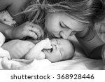 mother kisses her newborn baby .... | Shutterstock . vector #368928446