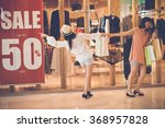 female shopaholics going by the ... | Shutterstock . vector #368957828