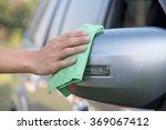 hand with green microfiber... | Shutterstock . vector #369067412