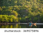 Stock photo fishing boats in sea and mangrove forest of thailand 369075896