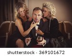 man being adored by two... | Shutterstock . vector #369101672