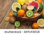Fresh juicy citrus fruits in a...