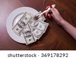 Small photo of one, ten, one hundred dollar bill face, old banknotes lie on a plate, female hand with red fingernails holding a fork, Breakfast of Champions millionaires, new brilliant conceptual idea, photography
