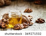 walnut oil in a small jar and... | Shutterstock . vector #369271532