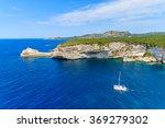 A White Catamaran Sailing On...