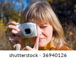 young woman making photos using ... | Shutterstock . vector #36940126