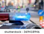 blue flashing police car during ... | Shutterstock . vector #369418946