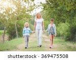 family walking in the summer... | Shutterstock . vector #369475508
