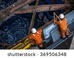 Two Workers At Jack Up Oil Rig...