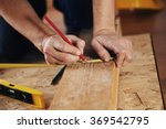 craftsman measuring wooden... | Shutterstock . vector #369542795