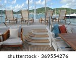 Small photo of Super Yacht Aft Deck with Lounge Chairs and View of Antigua Harbor, Caribbean