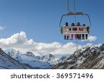 Chairlift Full Of Skiers At A...