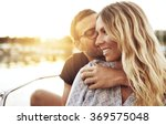 man kissing woman while woman... | Shutterstock . vector #369575048