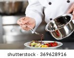 chef finishing her plate and... | Shutterstock . vector #369628916
