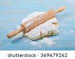 dough for pizza and rolling pin ... | Shutterstock . vector #369679262