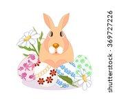 rabbit sitting on easter egg